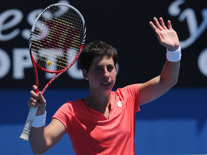 Carla Suarez Navarro waves to the crowd after winning her first round clash against Sara Errani at the Australian Open tennis championship on January 15, 2013