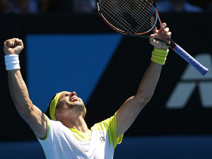 Spain's David Ferrer celebrates winning his fourth round match at the  Australian Open tennis championship on January 20, 2013