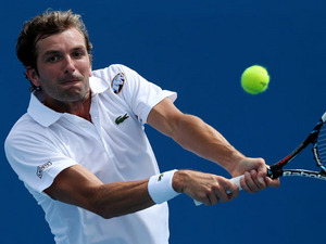 Julien Benneteau of France returns a shot during his first round match with Grigor Dimitrov in the Australian Open tennis championship on January 14, 2013