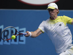 South African Kevin Anderson hits a forehand shot during his third round match against Fernando Verdasco at the Australian Open tennis championship on January 18, 2013