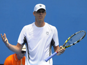 Sam Querrey reacts after losing a point in his second round match with Brian Baker at the Australian Open tennis championship on January 16, 2013