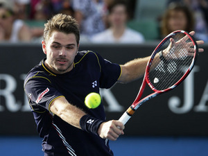 Stanislas Wawrinka hits a return shot during his third round match at the Australian Open tennis championship on January 18, 2013