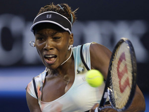Venus Williams hits a return shot during her second round match with Alize Cornet at the Australian Open tennis championship on January 16, 2013