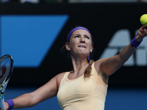 Victoria Azarenka of Belarus serves to Jamie Hampton during their third round match at the Australian Open tennis championship on January 19, 2013