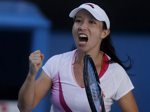 China's Zheng Jie celebrates during her second round with at the Australian Open tennis championship on January 16, 2013