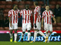 Stoke City player Kenwyne Jones celebrates with teammates after scoring in his sides FA Cup match on January 15, 2013