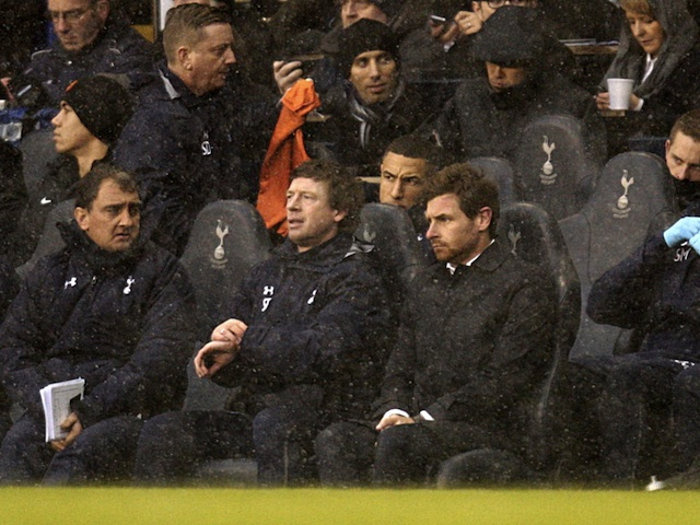 Spurs boss AVB sits in the dugout during the game with Man Utd on January 20, 2013