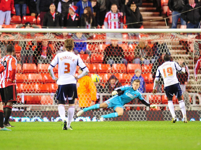 Bolton player Marvin Sordell scores a penalty in his sides FA Cup third round replay on January 15, 2013