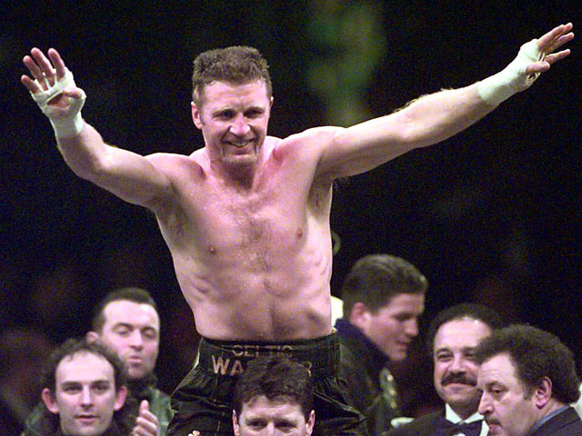 Ireland's Steve Collins celebrates defending his WBO Super Middleweight title on February 8, 1997