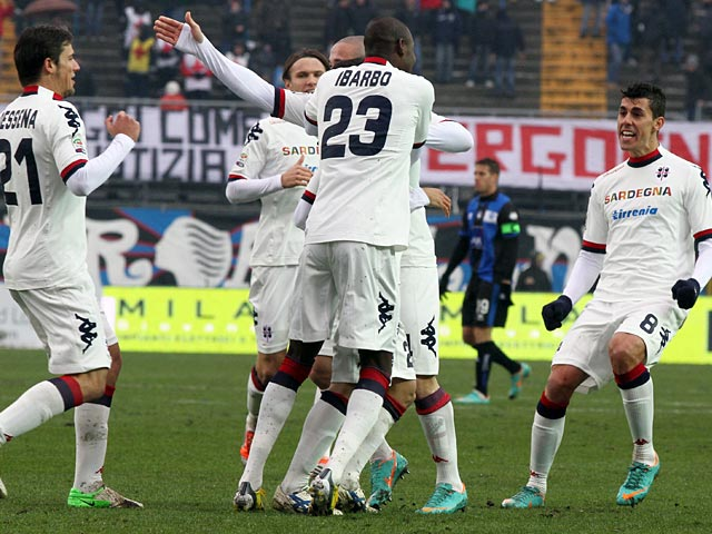 Cagliari players celebrate after opposition Atalanta score an own goal on January 20, 2013