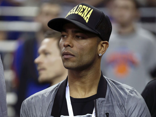 Chelsea soccer player Ashley Cole watches the New York Knicks and Detroit Pistons NBA basketball game at the 02 arena on January 17, 2013