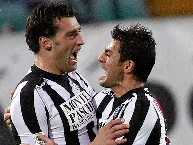 Siena's Erjon Bogdani is congratulated by Simone Vergassola after scoring against Sampdoria on January 20, 2013