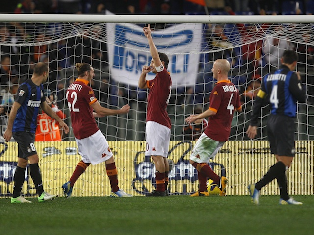 Roma forward Francesco Totti celebrates a goal against Inter Milan on January 20, 2013