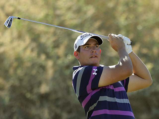 Scott Stallings hits of the 17th tee during the third round of the Humana Challenge golf tournament January 19, 2013