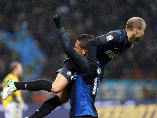Inter Milan player Rodrigo Palacio is carried by teammate Fredy Guarin as he celebrates scoring on January 15, 2013