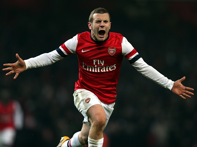 Jack Wilshere celebrates scoring the opening goal during the FA Cup third round replay against Swansea on January 16, 2013