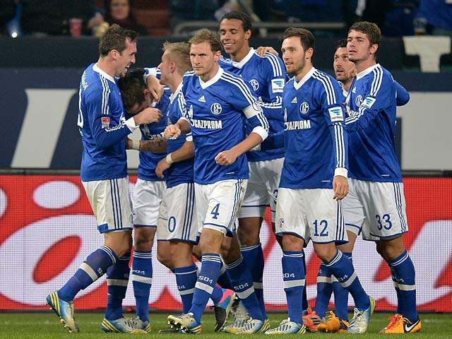Schalke's Julian Draxler is congratulated by team mates after scoring his team's second goal against Hannover on January 18, 2013