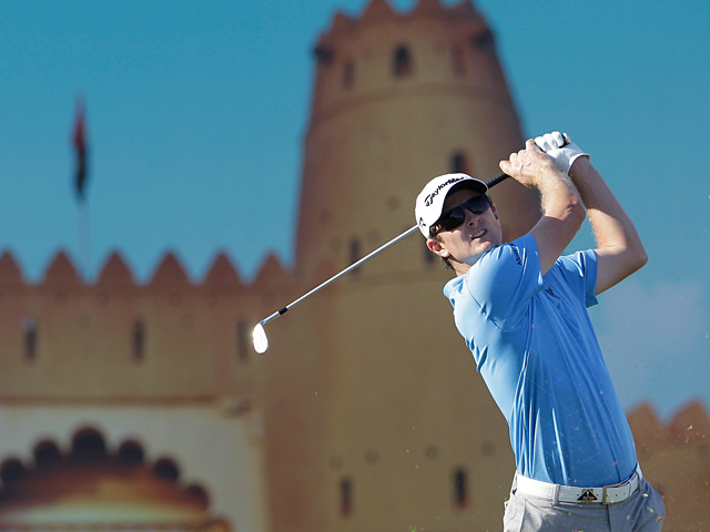 Justin Rose follows his ball after taking a shot at the 15th hole during the third round of Abu Dhabi Golf Championship on January 19, 2013