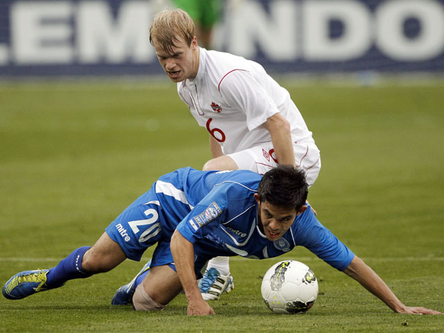 Kyle Bekker attempting to get the ball from Andres Flores during Canada's CONCACAF Olympic qualifying match on March 22, 2012