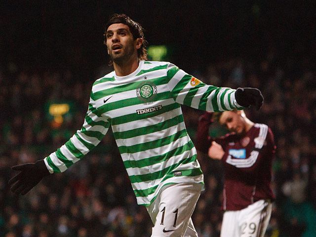 Celtic's Lassad Nouioui celebrates after scoring his team's fourth against Hearts on January 19, 2013