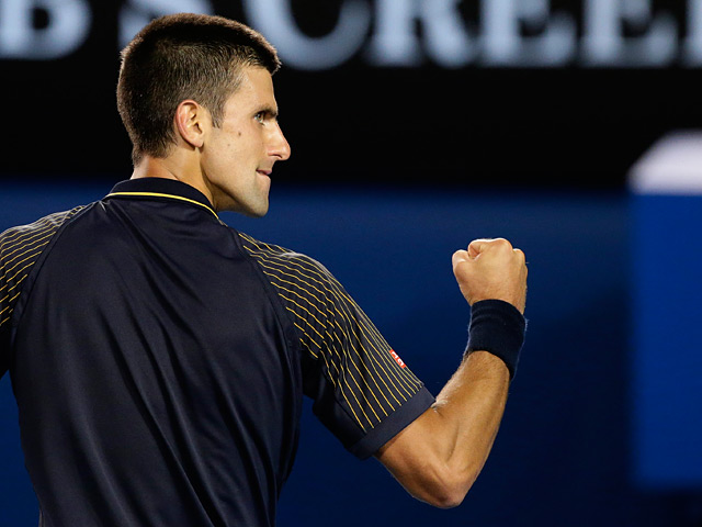 Novak Djokovic punches the air during the his fourth round match against Stanislas Wawrinka on January 20, 2013