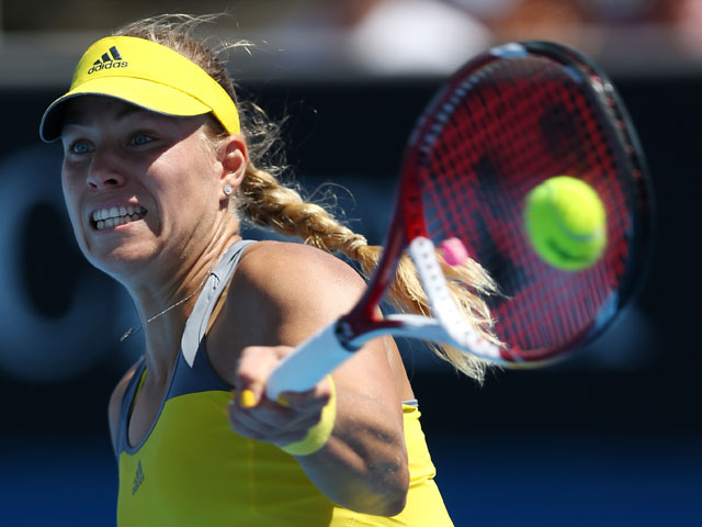 Angelique Kerber of Germany hits a return shot in her match with Lucie Hradecka in the second round of the Australian Open tennis championship on January 16, 2013
