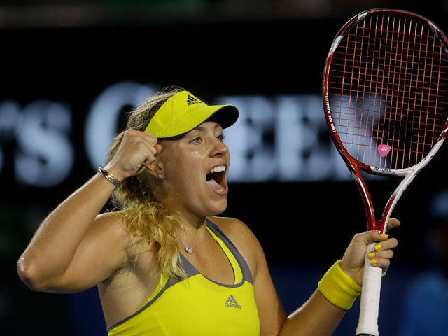 German Angelique Kerber celebrates after winning her third round match against Madison Keys at the Australian Open tennis championship on January 18, 2013