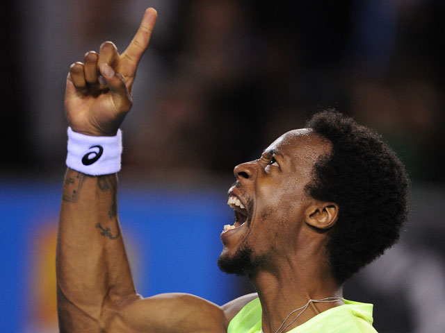 Frenchman Gael Monfils celebrates winning a point in his first round match at the Australian Open tennis championship on January 15, 2013