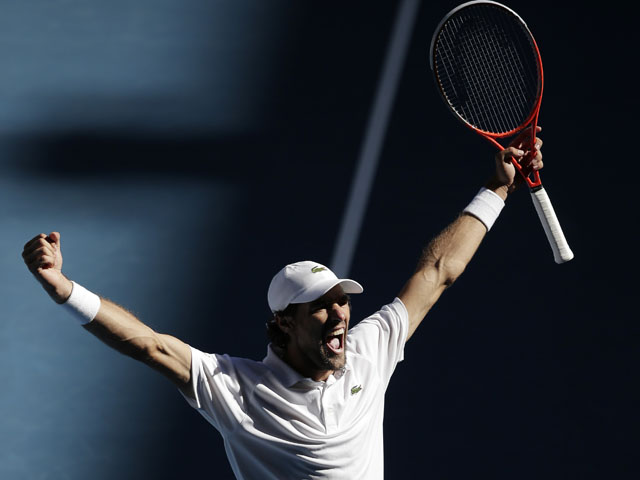 Frenchman Jeremy Chardy celebrates after defeating Juan Martin Del Potro in the third round of the Australian Open tennis championship on January 19, 2013
