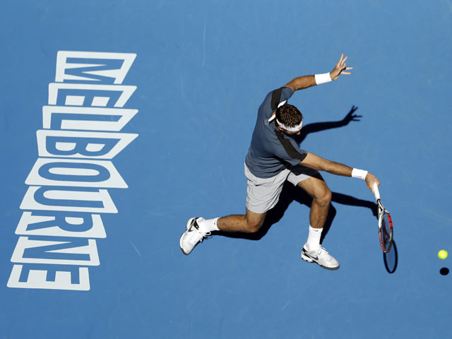 Juan Martin Del Potro plays a shot during his first round match against Adrian Mannarino in the Australian Open tennis championship on January 15, 2013