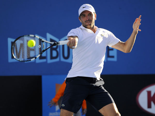 Frenchman Julien Benneteau in action during his second round match against Edouard Roger-Vasselin at the Australian Open tennis championship on January 16, 2013