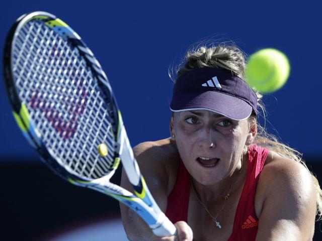 Ksenia Pervak of Kazakstan in action against Heather Watson at the Australian Open tennis championship on January 16, 2013