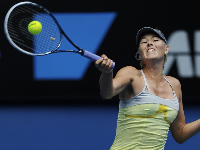 Russian Maria Sharapova returns a shot during her first round tie with Olga Puchkova during the Australian Open tennis championship on January 14, 2013