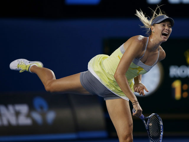 Russia's Maria Sharapova serves to Venus Williams during their third round clash at the Australian Open tennis championship on January 18, 2013