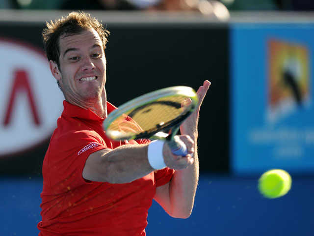 Frenchman Richard Gasquet hits a return during his first round match at the Australian Open tennis championship on January 15, 2013