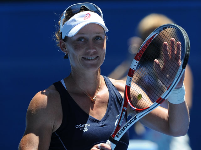 Australian Samantha Stosur waves to the home crowd after her first round win at the Australian Open tennis championship on January 14, 2013
