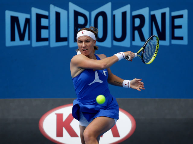 Russia's Svetlana Kuznetsova hits a forehand return during her third round match at the Australian Open tennis championship on January 19, 2013
