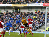 Brighton & Hove Albion's Ashley Barnes scores his side's first goal against Arsenal on January 26, 2013