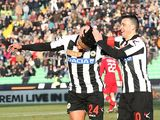 Udinese's Luis Muriel is congratulated by team mate Antonio Di Natale after scoring the opener against Siena on January 27, 2013