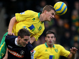 Norwich City's Ryan Bennett heads clear for his side in their match against Luton in the FA Cup fourth round on January 26, 2013