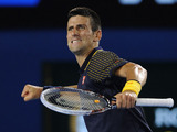 Novak Djokovic celebrates defeating David Ferrer at the Australian Open tennis championship on January 24, 2013