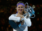 Victoria Azarenka hugs the trophy after retaining the Australian Open on January 26, 2013