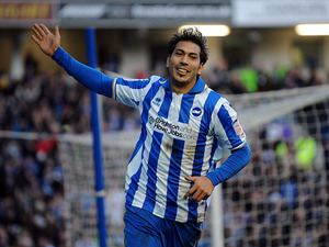 Brighton & Hove Albion's Jose Ulloa celebrates scoring his sides second goal in their match against Arsenal on January 26, 2013