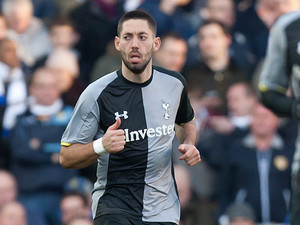 Clint Dempsey celebrates as he grabs a goal back for his team in the FA Cup fourth round tie against Leeds on January 27, 2013