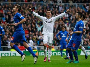 Cristiano Ronaldo celebrates scoring in the match against Getafe on January 27, 2013