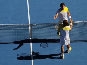 David Ferrer and Nicolas Almagro shake hands following their Australian Open quarter-final on January 22, 2013