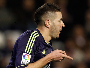 Real Madrid's Karim Benzema celebrates scoring the opening goal against Valencia on January 23, 2013