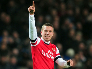 Lukas Podolski celebrates scoring the equaliser against West Ham on January 23, 2013