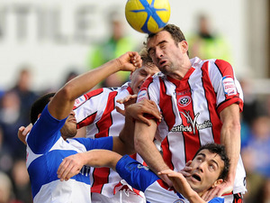 Sheffield United's Danny Higginbotham wins a header for his side in their match against Reading on January 26, 2013