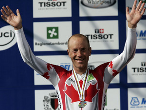 Canadian Svein Tuft celebrates his silver medal in the Men's Time Trial event, at the road World cycling Championships on September 25, 2008
